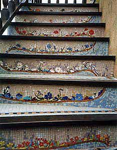 If you are looking for a piece of artwork for your yard, consider adding an outdoor mosaic, as they really tie yard features together. You can always mosaic your stairs!