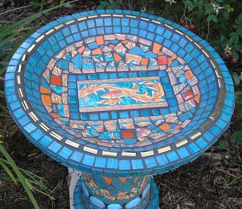 If you are looking for a piece of artwork for your yard, consider adding an outdoor mosaic, as they really tie yard features together. A mosaic bird bath is always a good idea!