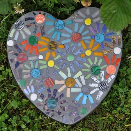 If you are looking for a piece of artwork for your yard, consider adding an outdoor mosaic, as they really tie yard features together. This stepping stone is so cute!