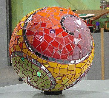If you are looking for a piece of artwork for your yard, consider adding an outdoor mosaic, as they really tie yard features together. A classic mosaic garden ball is always a good choice!