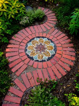 If you are looking for a piece of artwork for your yard, consider adding an outdoor mosaic, as they really tie yard features together. You can always add some brick to your mosaic to add some contrast!