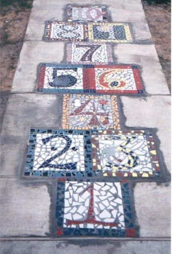 If you are looking for a piece of artwork for your yard, consider adding an outdoor mosaic, as they really tie yard features together. You can even add hopscotch for the kids!