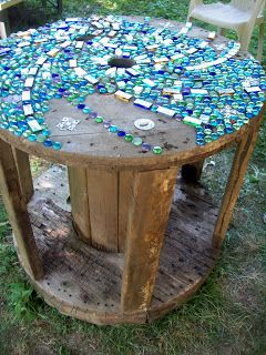 If you are looking for a piece of artwork for your yard, consider adding an outdoor mosaic, as they really tie yard features together. A mosaic table is a must!