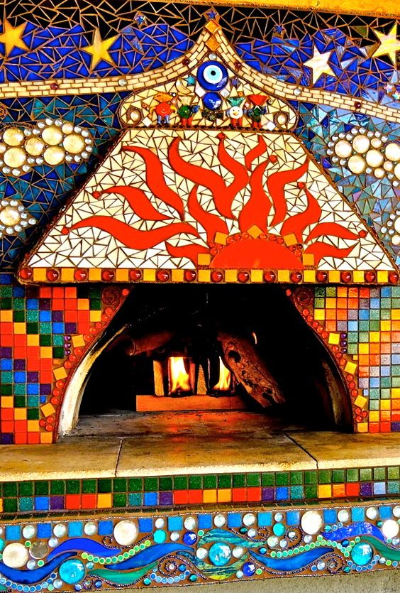 If you are looking for a piece of artwork for your yard, consider adding an outdoor mosaic, as they really tie yard features together. Mosaics will really up the look of your fireplace!