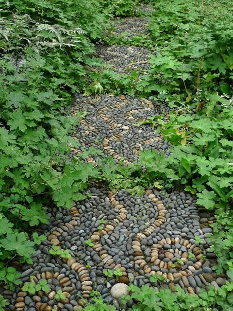 If you are looking for a piece of artwork for your yard, consider adding an outdoor mosaic, as they really tie yard features together. This colored rock is also a good idea!