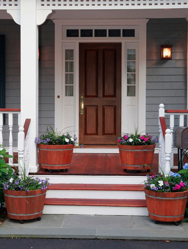 round wood garden planters on the front porch
