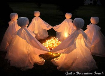 Circle of Ghosts holding hands with light in the middle making the ghosts glow.