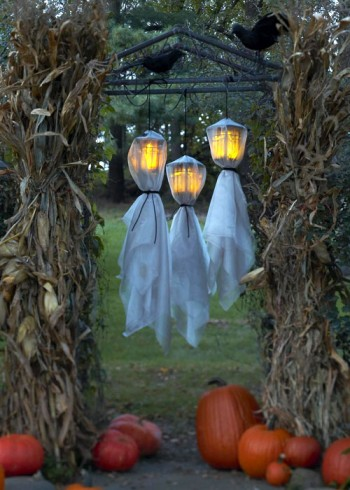 3 DIY Ghosts made with a sheet over some outdoor lights.